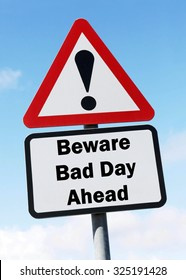 Red and white triangular road sign with warning to Beware of a Bad Day Ahead concept against a partly cloudy sky background