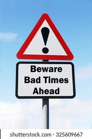 Red and white triangular road sign with warning to Beware of Bad Times Ahead concept against a partly cloudy sky background