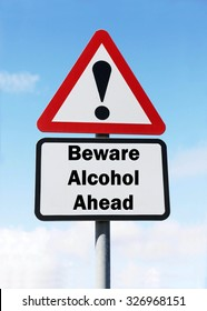 Red and white triangular road sign with warning to Beware of Alcohol  Ahead concept against a partly cloudy sky background