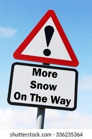 Red and white triangular road sign with a More Snow On The Way concept against a partly cloudy sky background