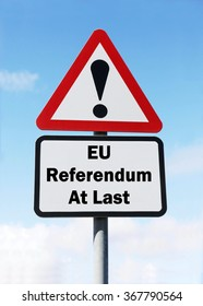 Red and white triangular road sign with an EU Referendum At Last concept against a partly cloudy sky background