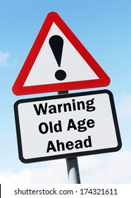 Red and white triangular warning road sign with a warning about old age ahead concept against a partly cloudy sky background