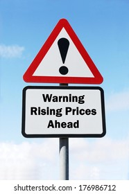 Red and white triangular warning road sign with a warning of rising prices ahead concept against a partly cloudy sky background