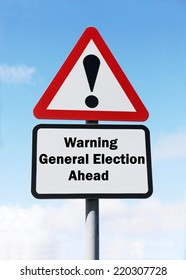 Red and white triangular warning road sign with a warning of an General Election ahead concept against a partly cloudy sky background