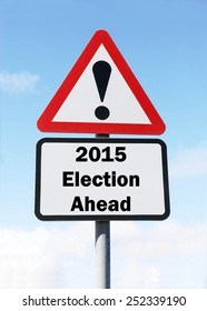Red and white triangular warning road sign with a warning of the 2015 Election Ahead during an election campaign concept against a partly cloudy sky background
