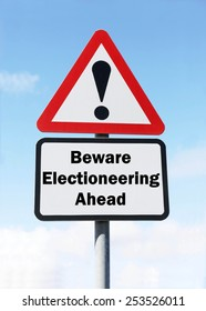 Red and white triangular warning road sign with a warning of Electioneering ahead concept against a partly cloudy sky background