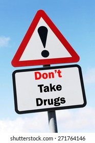 Red and White triangular warning road sign with a Don't Take Drugs concept against a partly cloudy sky background.