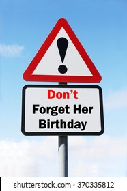 Red and White triangular warning road sign with a Don't Forget Her Birthday concept against a partly cloudy sky background.