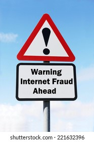 A red and white warning road sign with an Internet Fraud ahead concept. against a partly cloudy sky background.
