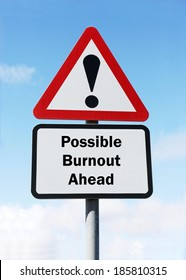 A red and white warning roadsign with a possible burnout ahead concept. against a partly cloudy sky background.