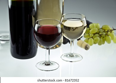 Red and white wine bottles and glasses