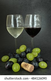 Red and white wine with colours grapes and cork. - Shutterstock ID 484126090