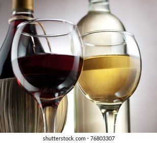 Red and white wine in elegant setting