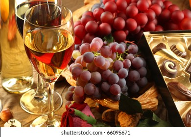 Red and white wine, fruits and rose.