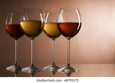 Red and white wine in glasses close up