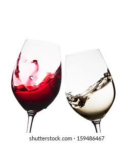 Red and white wine glasses isolated