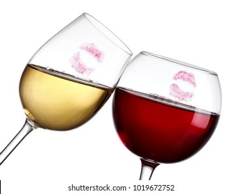 Red and white wine glasses with lipstick stams