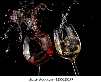 Red and white wine glasses splash with drops