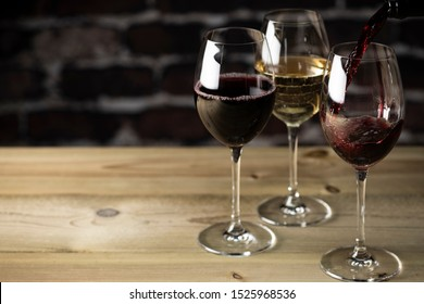 Red and white wine on wood table