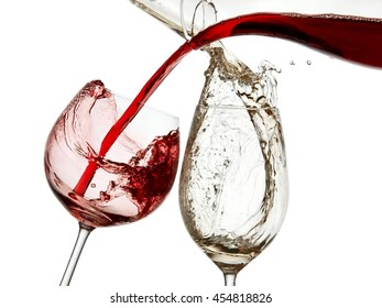 Red and white wine pouring from decanters