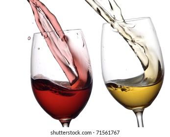 Red and white wine splash closeup