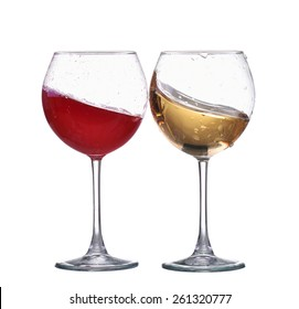 Red and white wine splash wave in glass isolated on white background