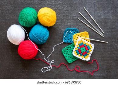 Red, white yarn, crocheted motifs on black