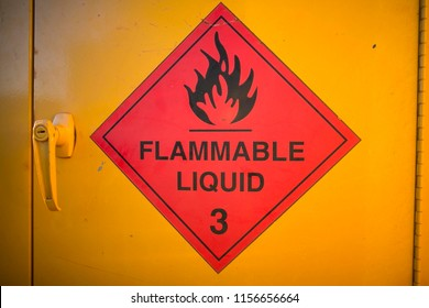 Red whitten flammable liquid 3 sign with yellow background