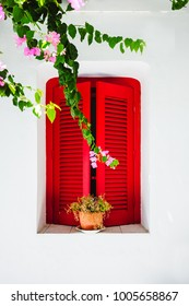 Red window in greek village, Paros, Greece