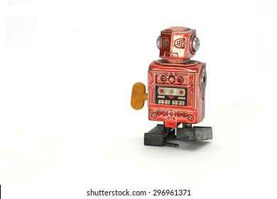 red windup robot without arms is more than 30 years old