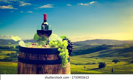 Red wine with barrel on vineyard in Chianti, Tuscany, Italy