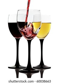 Red wine being poured in a wine glass and two glasses with white and red wine on a background