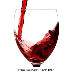 Red wine being poured in a wine glass