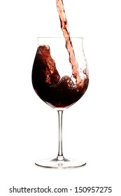 Red wine being pourred into a glass