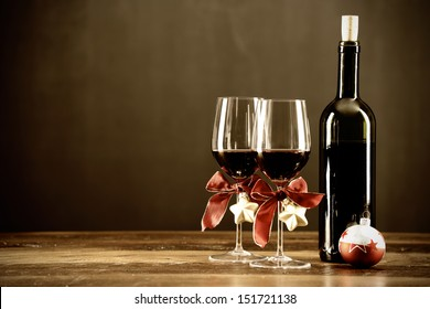 Red wine, bottle and christmas ornaments, selctive focus