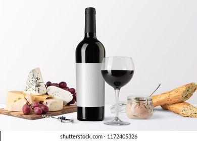 Red wine bottle mockup, with wine glass, food snacks and blank label to place your design