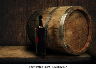 Red wine bottle on a old oak wooden table background barrel.
