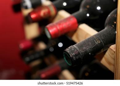 Red wine bottles in wine vault