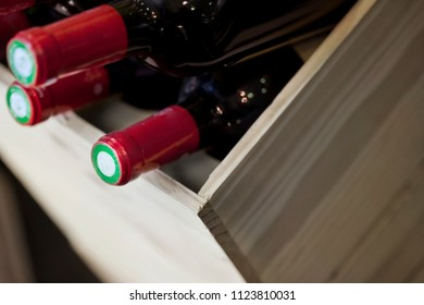 Red wine bottles in a wooden box
