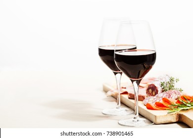 Red wine and charcuterie assortment on the board