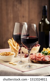 Red wine with charcuterie, cheese, grapes and snacks