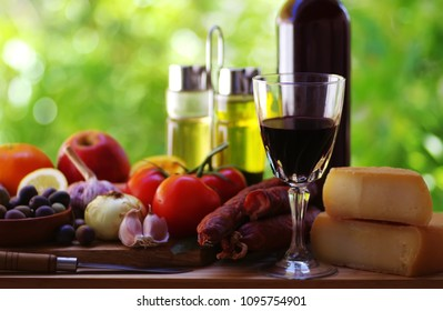 Red wine, cheese and meat, fruits and vegetables