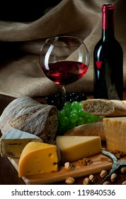Red wine with cheeses, bread and fruits