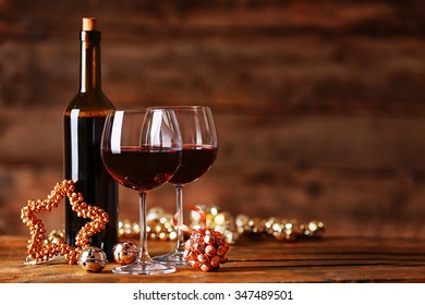 red wine and christmas ornaments on wooden table on wooden background - Wine Christmas
