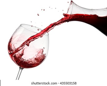 Red wine flow in a glass from a decanter
