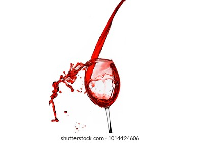 red wine flowing and splashing  into glass on isolated white background