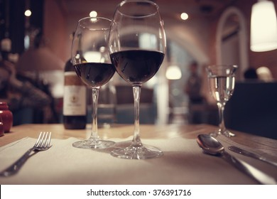 red wine in a French restaurant interior