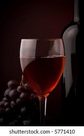 red wine glass  bottle details grape