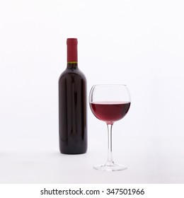 Red Wine. Glass and bottle of red wine. Top view unusually on white background.
