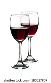 Red wine in glass. Isolated on white background